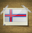 Flags Faroe Islands at frame on a brick background vector image