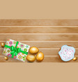 golden easter eggs cake and gift box on wooden vector image