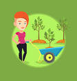 woman pushing wheelbarrow with plant vector image vector image