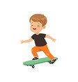 cute little boy riding skateboard kids physical vector image vector image