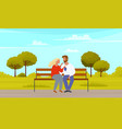 man and woman sitting on bench outdoors couple vector image