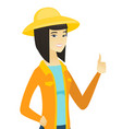 young asian farmer giving thumb up vector image vector image