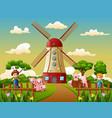 cartoon two boy is herding pigs in the windmill bu vector image