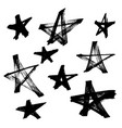 set of black hand drawn stars in doodle style vector image vector image