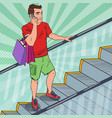 pop art young man with shopping bags on escalator vector image