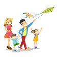 young caucasian white family playing with a kite vector image vector image