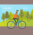 smiling man riding bicycle near green trees vector image vector image