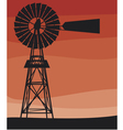 silhouette a water pumping windmill vector image vector image