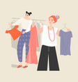 two young women choose clothes in store vector image