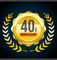 40 years anniversary gold and red badge logo vector image vector image