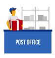 delivery man in blue uniform holding red gift box vector image