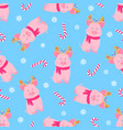 cute pig sitting in a scarf and with deer horns vector image vector image