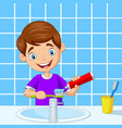 cute little boy brushing teeth in bathroom vector image vector image