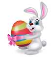 Cute rabbit cartoon holding easter egg vector image vector image