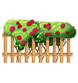A fence with flowering plants vector image vector image