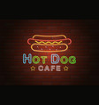 glowing neon signboard hotdog cafe on brick wall vector image
