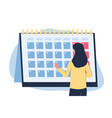 woman looking at monthly calendar - menstruation vector image