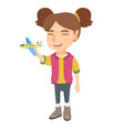 caucasian cheerful girl playing with toy airplane vector image vector image