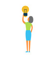 woman holds bright light bulb vector image
