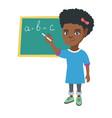 african schoolgirl writing on the blackboard vector image vector image