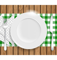 Clean plate with knife fork and napkin on wooden vector image vector image