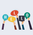 hands holding speech bubbles with the word hello vector image