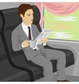 Businessman reading newspaper on train vector image