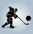Silhouette of a hockey player with puck vector image