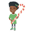 african little girl holding christmas candy cane vector image vector image