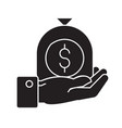 hand with money bag black concept icon vector image