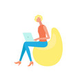 woman sitting on bean chair and working on laptop vector image vector image