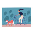 young woman riding bicycle in park with dog vector image vector image