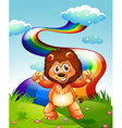 A happy lion at the hilltop with a rainbow in the vector image vector image