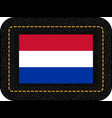 flag of netherlands icon on black leather vector image vector image