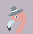 pink flamingo in a brown hat vector image
