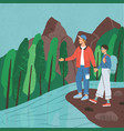 young man and woman standing at river and holding vector image vector image