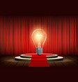 light bulb stands on stage with a curtain vector image vector image