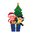 christmas elf with boy and gift vector image
