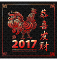 Chinese year of rooster made by Chinese paper cut vector image vector image