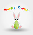 easter bunny with egg icon flat vector image vector image