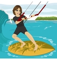 Female kiteboarder enjoys surfing waves vector image