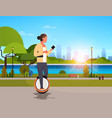 woman ride electric mono wheel using smartphone vector image vector image