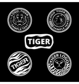 Set of logos with tigers striped icons and lagels vector image vector image