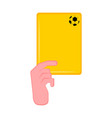 hand holding a yellow card vector image