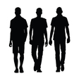 man walking three black silhouette vector image vector image