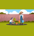 couple farmers planting young tree man holding vector image vector image
