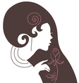 Beautiful woman silhouette with a flower vector image