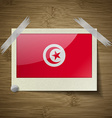 Flags Tunisia at frame on wooden texture vector image