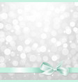 silver glitter bokeh with bow vector image