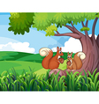Two wild animals under the tree vector image vector image